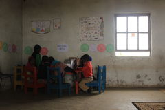 Group of african children studying by a desk in rural Swaziland Stock Images