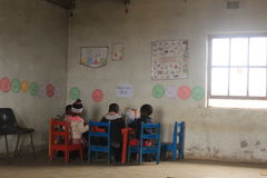 Group of african children studying by a desk in rural Swaziland Stock Photo
