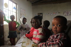 Group of african children studying in school in rural Swaziland, Africa Stock Photo