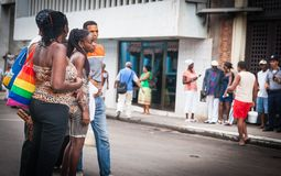 Group of African young adults in city street. HAVANA CUBA - JULY 8 2012; Four Afro-Cuban young adults standing  together in middle city street stock image