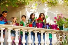 Happy multiethnic children making terrace garden royalty free stock images