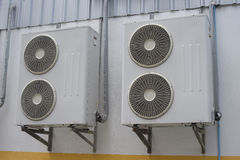 Group of air conditioner units on wall outside building Stock Image