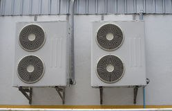 Group of air conditioner units on wall outside building Royalty Free Stock Photo
