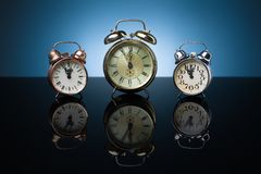 Group of alarm clocks, blue background Royalty Free Stock Photo