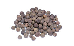 Group of allspice on white background. Isolated group of allspice on white background stock photo
