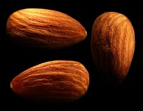 Group of almond on black background. Close-up Royalty Free Stock Photo