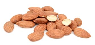 Group of almond nuts. Group of almond nuts with leaves isolated on white background Stock Photos