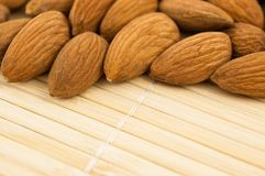 Group of almonds on a bamboo mat. Royalty Free Stock Photography