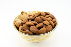 Group of almonds in a bowl on white background stock images