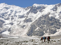 A group of alpinists is in the mountains Stock Images