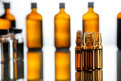 Group of ampoules with a transparent medicine in medical laboratory. Group object of liquid medicinal agent in limpid glassware in medical laboratory. Group of Royalty Free Stock Photo