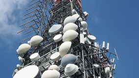 Group of antennas, satellite dishes for telecommunications, television broadcast, cellphone, radio and satellite on Linzone. Mountain peak. Electromagnetic and stock video
