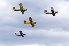 Group of Antonov An-2 biplanes flying Stock Photos