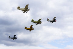 Group of Antonov An-2 biplanes flying Stock Images
