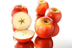 Group of apples. In group on the mirror with white background royalty free stock photo