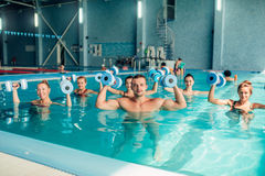 Group aqua aerobics traninig in indoor pool Stock Photo