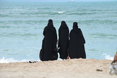 Group of arab women. On the beach Stock Image