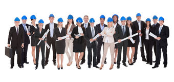 Group Of Architects With Blue Print Royalty Free Stock Images