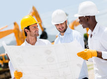 Group of architects at a construction site Royalty Free Stock Photos