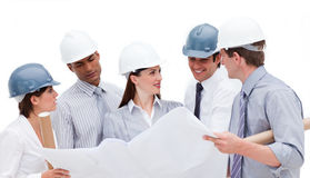 Group of architects discussing a construction plan Royalty Free Stock Image