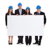 Group of architects holding placard Royalty Free Stock Image
