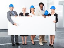Group of architects holding placard Stock Images