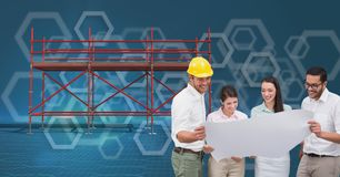 A group of architects looking a blueprint and 3D scaffolding with blue background. Digital composite of A group of architects looking a blueprint and 3D Stock Image