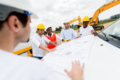 Group of architects looking at blueprints Royalty Free Stock Image