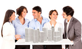 Group of architects with a building project Stock Photography