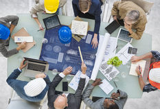 Group of Architects Planning with Blueprint.  stock photo