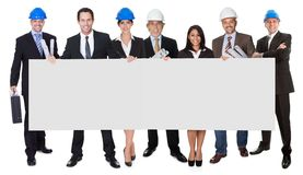 Group of architects presenting empty banner Stock Image