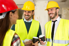 Group of architects talking on coffee break at construction site Stock Images