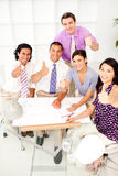 A group of architects with thumbs up in a meeting Stock Photography