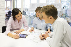 Group of architects working in office on tablet pc Stock Photography