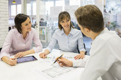 Group of architects working in office on tablet pc Royalty Free Stock Images