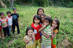 Group of Asia children. KHANH HOA, VIET NAM- FEB 16: Group of unidentified Asia children in countryside, kid have pretty, lovely face sitting on meadow and smile stock images