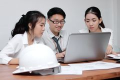 Group of Asian business people working with laptop together in modern office. Selective focus and shallow depth of field. Group of Asian business people working Royalty Free Stock Image