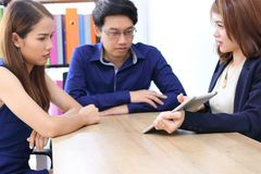 Group of Asian business people working together in modern office stock images