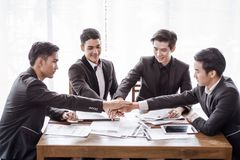 Group asia businessman together create a mutually beneficial business relationship. Economic graph on the table royalty free stock photography
