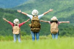 Group asian family children raise arms and standing see the outdoors, adventure and tourism for destination and leisure trips with