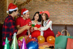 Asian friends toast champagne. Christmas party royalty free stock photography