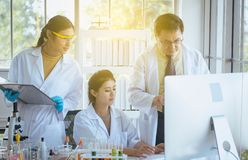 Group of asian medical student research new project with senior professor together at laboratory royalty free stock photos