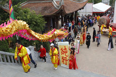 A group of Asian people dance dragon in folk festivals Royalty Free Stock Images