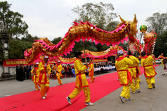 A group of Asian people dance dragon in folk festivals Stock Photography
