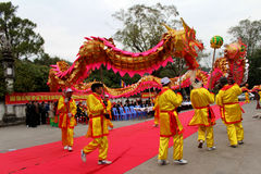 A group of Asian people dance dragon in folk festivals Royalty Free Stock Image