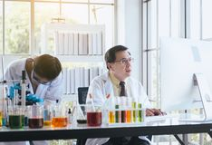 Group of asian scientist working and explaining research information together in the laboratary stock images