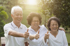 Group of Asian seniors showing thumbs up Royalty Free Stock Photo