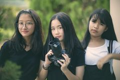 Group of asian teenager with dslr camera in hand. Group of asian teenager  with dslr camera in hand royalty free stock images