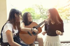 Group of asian teenager happiness emotion playing spanish guitar on location. Group of asian teenager  happiness emotion playing spanish guitar on location royalty free stock images