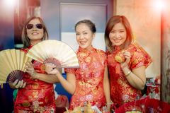 Group of asian woman wearing chinese tradition clothes toothy smiling face happiness emotion and hand sign i love you stock photography